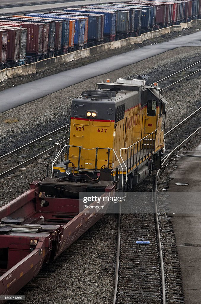 A Union Pacific Corp. switching locomotive positions well cars to be loaded with intermodal containers at the Union Pacific Intermodal Terminal in Oakland, California U.S., on Wednesday, Jan. 23, 2013. Union Pacific Corp., the largest U.S. railroad by sales, posted higher fourth-quarter earnings than analysts estimated as shipments of chemicals and automobiles climbed. Photographer: Ken James/Bloomberg via Getty Images