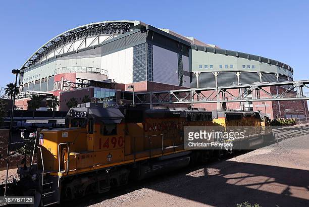 Union Pacific Railroad train passes by Chase Field before the MLB game between the Arizona Diamondbacks and the San Francisco Giants on April 29 2013...