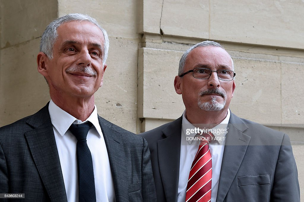 CFTC union president Philippe Louis (L) and CFTC general secretary Bernard Sagez arrive for a meeting with French Prime minister and French Labour minister on the Socialist government's labour reforms, at the Hotel Matignon in Paris on June 29, 2016. / AFP / DOMINIQUE