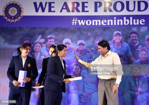 Union Railway Minister Suresh Prabhu with India Women's Cricket player at a felicitating event on July 27 2017 in New Delhi India Mithali Raj led...