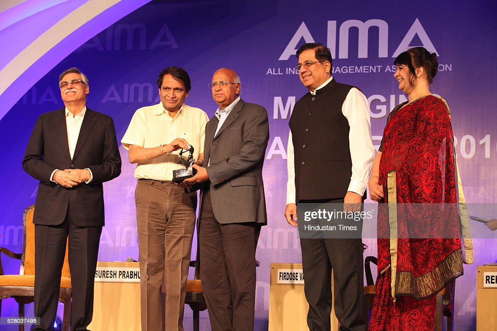 Union Railway Minister Suresh Prabhu (2L) with S Ramadorai (C), Chairman of National Skill Development Agency (NSDA) in the rank of a Cabinet Minister and Chairman of National Skill Development Corporation (NSDC), during the All India Management Association (AIMA)s Managing India Awards 2016 at Hotel Taj Palace in New Delhi, India.