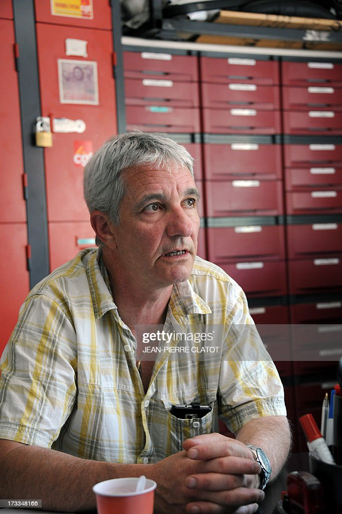 CGT union representative for the Rio Tinto Alcan (RTA) aluminum factory Yannick Bacaria, speaks to a journalist at his office on July 12, 2013 in Saint-Jean-de-Maurienne, southeast of France. Heads of Rio Tinto Alcan and Germany's Trimet met today in Paris regarding the take over of RTA by Trimet which could save 510 jobs at the two sites of Saint-Jean-de-Maurienne and Castelsarrasin. AFP PHOTO / JEAN PIERRE CLATOT