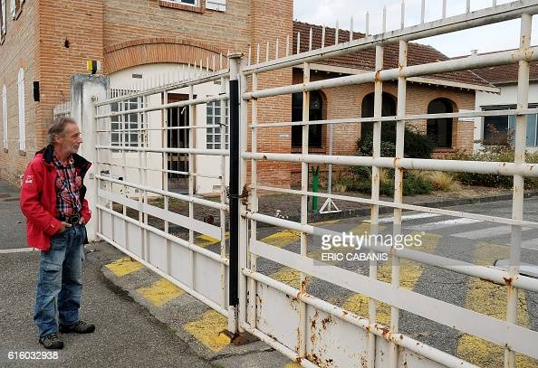 HVIEN CGT union representative Guy Pavan stands in front of the entrance of the closed Molex factory on October 5 2016 in VillemursurTarn southern...
