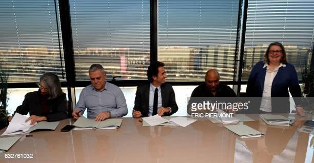 CGC Union representative Laurence Gnonlonfoun CFTC union representative Bruno Marc French retail chain FNAC chairperson Alexandre Bompard CFDT Union...