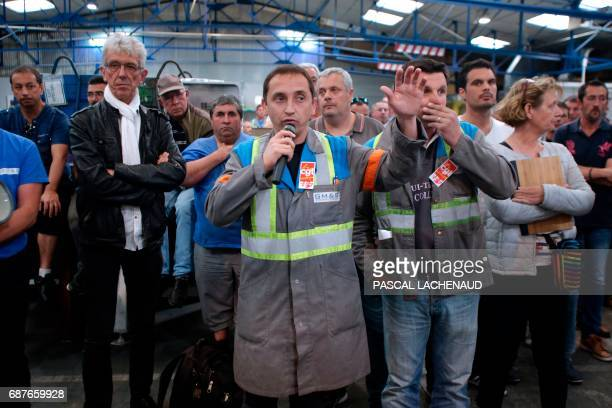 CGT union representative Vincent Labrousse speaks next to lawyer of workers JeanLouis Borie during a general assembly on May 24 2017 in La...