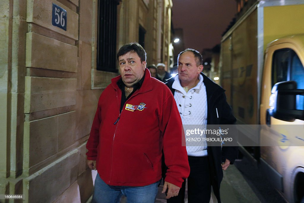 Union representatives of the Petroplus oil refinery arrive for a meeting at the Hotel Matignon, the Prime Minister official residence, in Paris on February 4, 2013. A French court ordered last October the liquidation of Peti-Couronne oil refinery despite two offers for the site that employs 470 people. TRIBOUILLARD