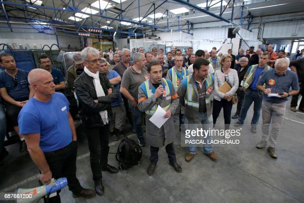 CGT union representatives Patrick Brun Vincent Labrousse and Yann Augras and lawyer of workers JeanLouis Borie take part in a general assembly on May...