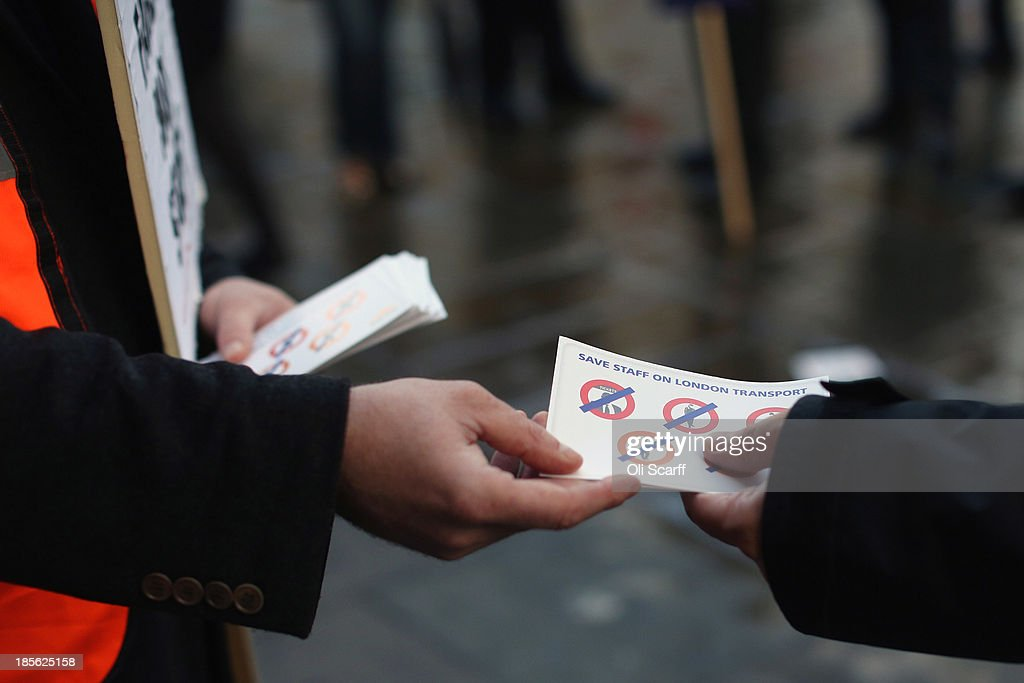 A union representitive hands out leaflets as campaign groups protest outside Oxford Circus tube station against plans to reduce staff on transport routes across the Capital on October 23, 2013 in London, England. The proposed changes include the closure of London Underground ticket offices and the removal of guards on London Overground trains.