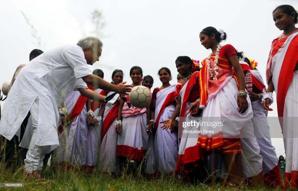 Union Rural Development Minister Jairam Ramesh giving soccer tips to young tribal girls who are players of Yuva Football Club after he donated a mini-bus for ferrying them in a function at Hutab Rukka Village on September 12, 2013 near Ranchi, India. Ranchi based team which consists mainly of tribal girls between 12 to 14 years of age created history as they finished third among 10 all-girls teams from Spain playing for the Gasteiz Cup in Victoria Gasteiz in Spain on July 13. The girls were coached by Franz Gastler , who founded Yuva India Trust which uses sport and education to tackle child marriage and human trafficking problems.
