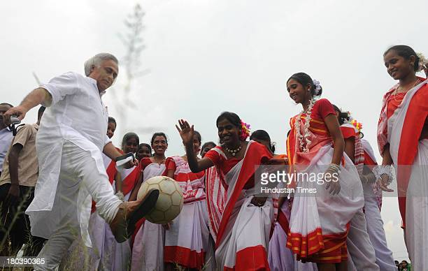 Union Rural Development Minister Jairam Ramesh giving soccer tips to young tribal girls who are players of Yuva Football Club after he donated a...