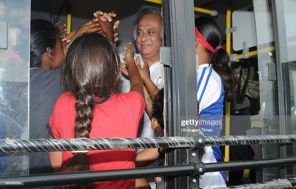 Union Rural Development Minister Jairam Ramesh meeting with young tribal girls who are players of Yuva Football Club inside a bus he donated for ferrying them in a function at Hutab Rukka Village on September 12, 2013 near Ranchi, India. Ranchi based team which consists mainly of tribal girls between 12 to 14 years of age created history as they finished third among 10 all-girls teams from Spain playing for the Gasteiz Cup in Victoria Gasteiz in Spain on July 13. The girls were coached by Franz Gastler , who founded Yuva India Trust which uses sport and education to tackle child marriage and human trafficking problems.