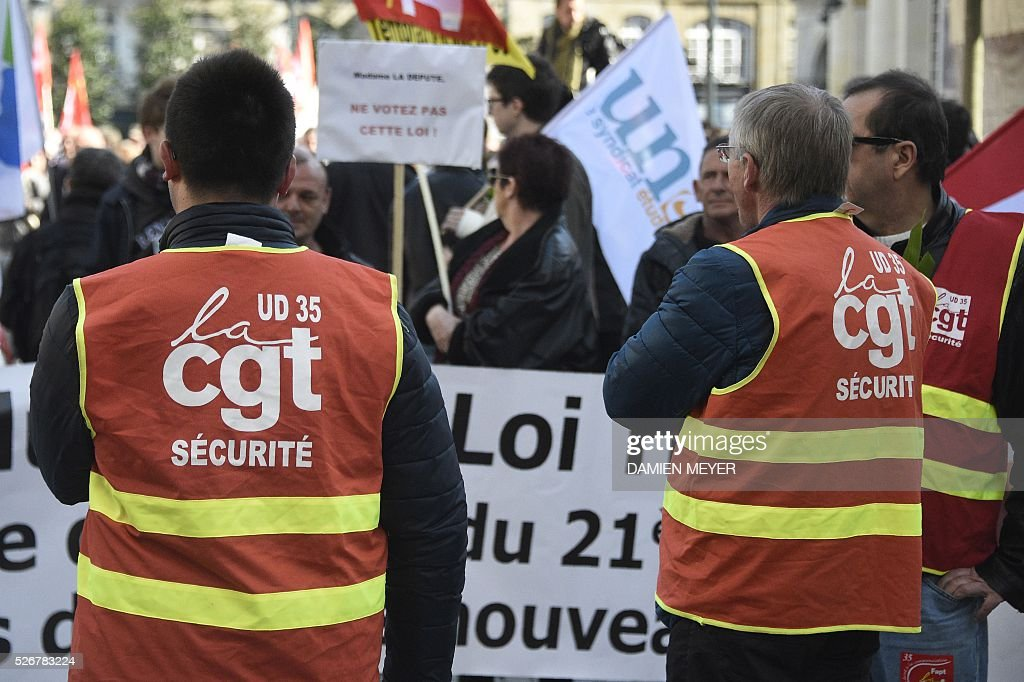 CGT union security personnel attend a May Day rally in Rennes, western France, on May 1, 2016. / AFP / DAMIEN