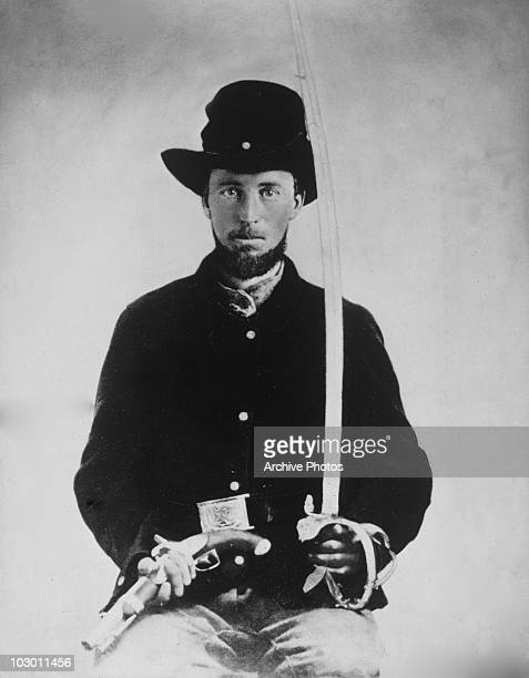 A Union soldier in uniform during the American Civil War holding a sword and a pistol USA circa 1863