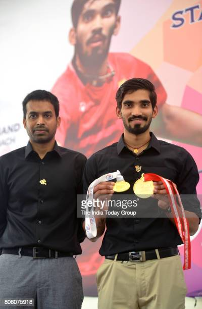 Union Sports Minister Vijay Goel congratulates Kidambi Srikanth the winner of Indonesian and Australian Open Super Series 2017 and P Gopichand in New...