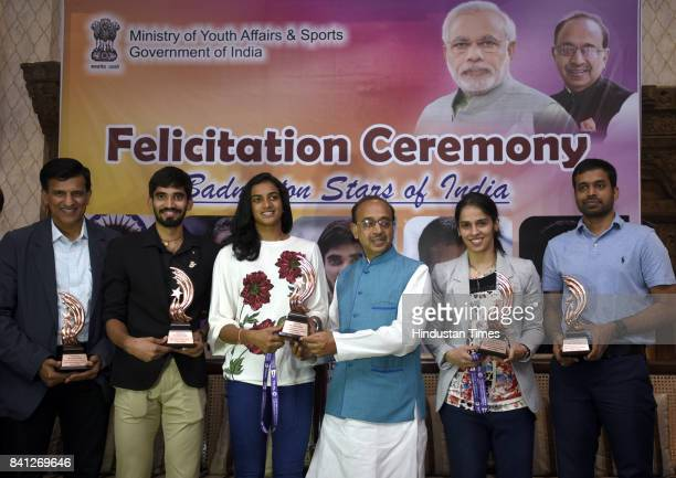 Union Sports Minister Vijay Goel felicitates Badminton players Saina Nehwal PV Sindhu Srikanth Kidambi and their coaches P Gopichand and Vimal Kumar...