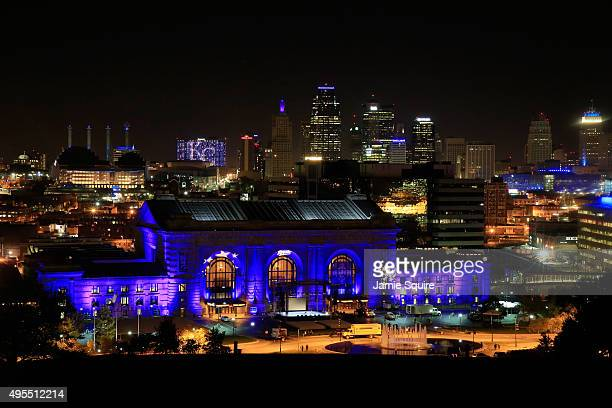 Union Station is lit up with blue lights in front of the Kansas City skyline ahead of a parade and celebration in honor of the Kansas City Royals'...