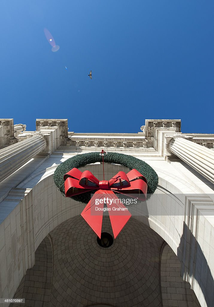 Union Station is prepared for the holiday's in this photo of one of three giant wreaths hanging in front of the train station in Washington on Nov. 21, 2013.
