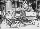 Union strikers ride a car during a demonstration possibly during the Pittsburgh Steel Strike 1919 The car is painted with the slogan 'United We...