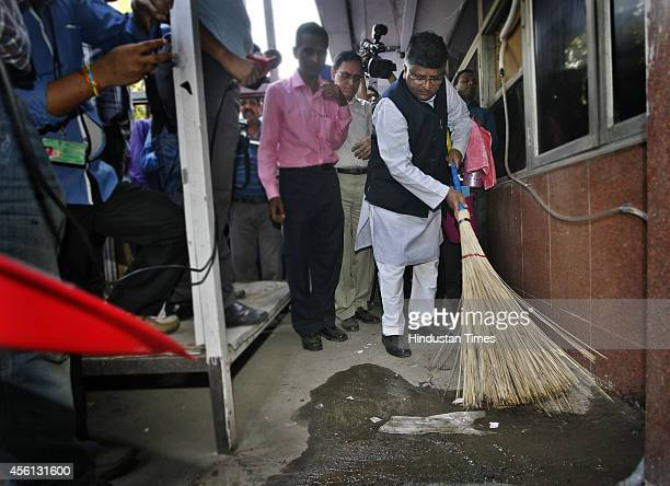 Union Telecom IT and Law Minister Ravi Shankar Prasad wields broom as he launched cleanliness drive at Shastri Bhawan compound as part of the Prime...