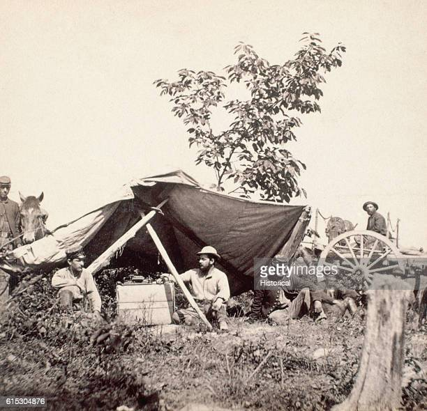 Union telegraph operators use a crude shelter to house their equipment at Wilcox's Landing Virginia ca June 1864 | Location Wilcox's Landing Virginia...