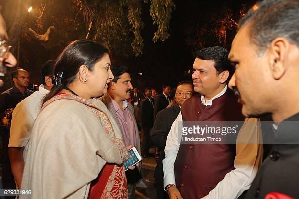 Union Textile Minister Smriti Irani speaking with Maharashtra Chief Minister Devendra Fadnavis at the wedding reception of Union Minister Nitin...