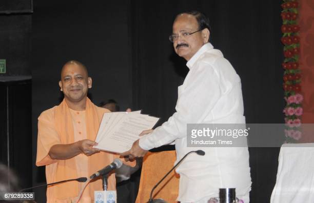 Union Urban Development Minister M Venkaiah Naidu hands over the release order of Rs 1263 crore for different projects and papers regarding the...