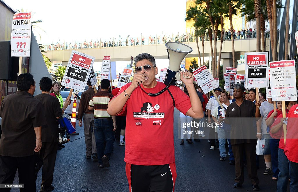 Union worker Alfredo Benuelos (C) uses a megaphone to lead chants as workers picket on the Las Vegas Strip outside The Cosmopolitan of Las Vegas on June 14, 2013 in Las Vegas, Nevada. The demonstration is in response to stalled negotiations with the hotel-casino, where 2,000 members of the Culinary Workers Union have been without a contract for more than two years. The Culinary, which represents 55,000 workers, is also in negotiations with MGM Resorts International and Caesars Entertainment Corp.