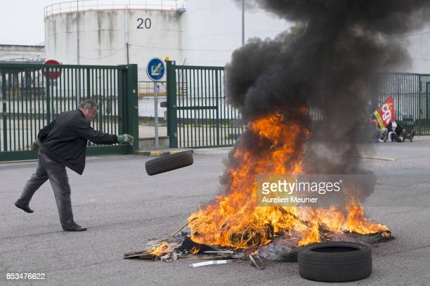 Union workers block access to a refinery by setting a fire at the entrance gate on September 25 2017 in Rouen France Truckers and refinery workers...