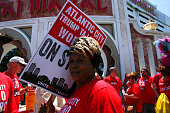 Union workers from local 54 take part in a rally outside the Trump Taj Mahal in Atlantic City as US Democratic presidential candidate Hillary Clinton...