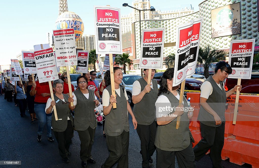 Union workers picket on the Las Vegas Strip outside The Cosmopolitan of Las Vegas on June 14, 2013 in Las Vegas, Nevada. The demonstration is in response to stalled negotiations with the hotel-casino, where 2,000 members of the Culinary Workers Union have been without a contract for more than two years. The Culinary, which represents 55,000 workers, is also in negotiations with MGM Resorts International and Caesars Entertainment Corp.