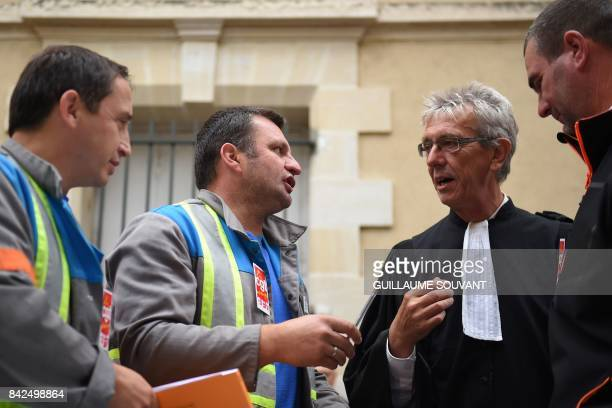 CGT unionist of the French auto parts manufacturer GMS company Yann Augras and GMS employees' lawyer JeanLouis Borie speak at the trade court of...