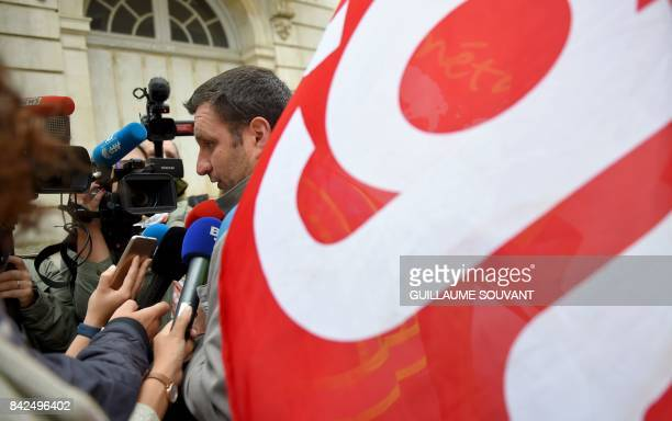 CGT unionist of the French auto parts manufacturer GMS company Yann Augras speaks to the press outside the trade court of Poitiers central France on...