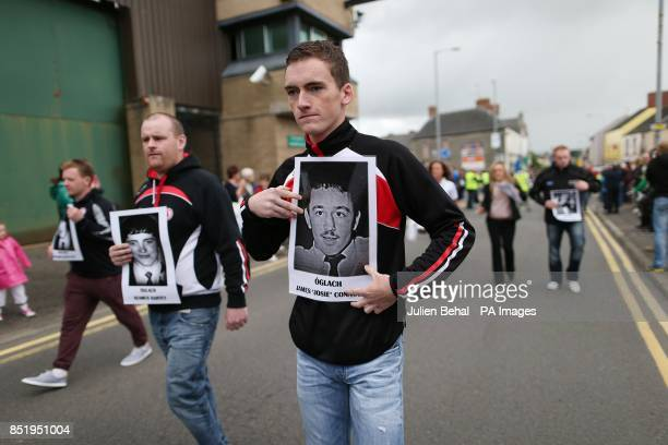 Unionists carry pictures of dead IRA volunteers past Castlederg PSNI station in Castlederg County Tyrone during the controversial parade by IRA...