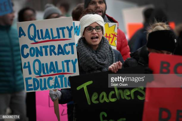 Unionized teachers with ASPIRA charter school network rally outside an ASPIRA high school to convince the company's management to come to terms on a...