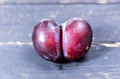 Unique and not ordinary plum. Plum in the form of an ass. Unique plum.