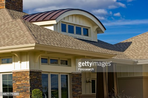 Unique dormer design with custom home stock photo getty for Unique custom home plans