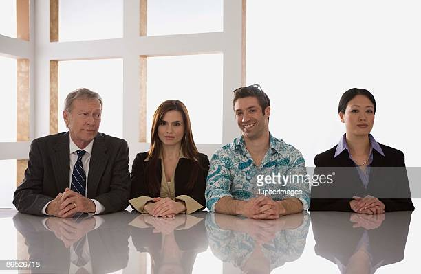 Unique man with businesspeople