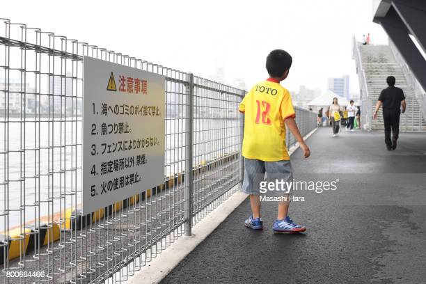 Unique rules of the stradium'No Littering to the sea' and 'No Fishing' with fan of Giravanz Kitakyushu prior to the JLeague J3 match between Giravanz...