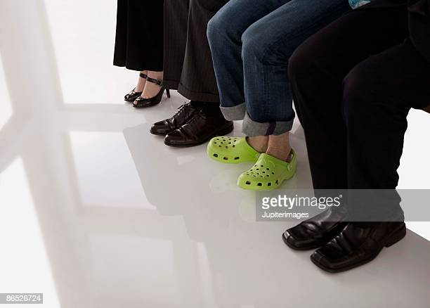 Unique shoes with businesspeople