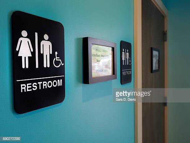 Unisex signs hang outside bathrooms at Toast Paninoteca on May 10 2016 in Durham North Carolina Debate over transgender bathroom access spreads...