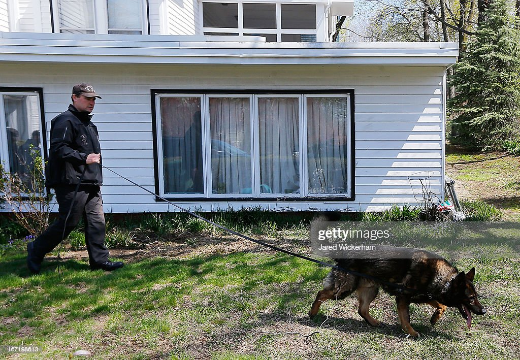 A K-9 unit execute a second sweep of the area around Franklin Street on April 22, 2013 in Watertown, Massachusetts. A manhunt ended for Dzhokhar A. Tsarnaev, 19, a suspect in the Boston Marathon bombing after he was apprehended on a boat parked on a residential property in Watertown, Massachusetts. He has been charged with one count of using a weapon of mass destruction and one count of malicious destruction of property by means of an explosive device resulting in death. His brother Tamerlan Tsarnaev, 26, the other suspect, was shot and killed after a car chase and shootout with police. The bombing, on April 15 at the finish line of the marathon, killed three people and wounded at least 170.