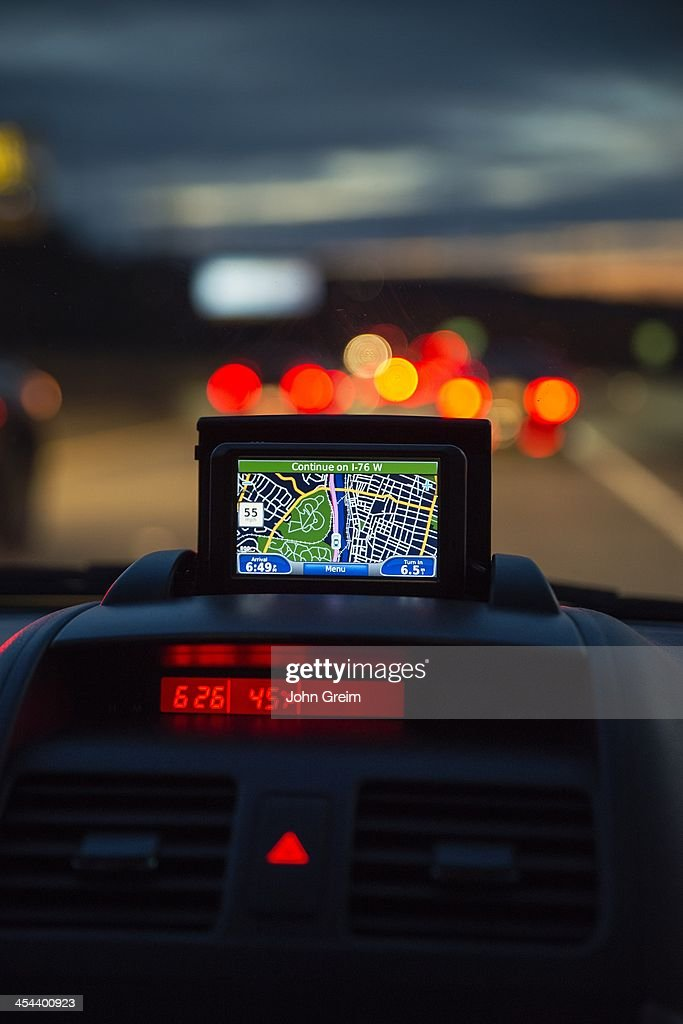 GPS unit in the window of a car in traffic