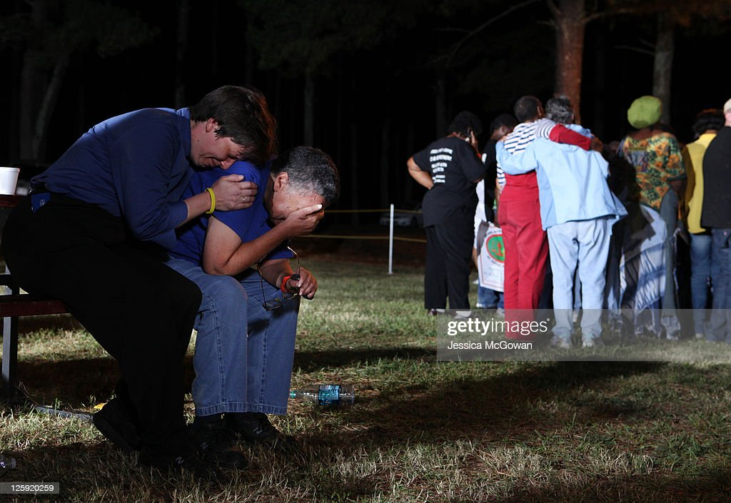 Unitarian minister Lynn Hopkins (L) consoles her spouse, Carolyn Bond, after hearing news that the US Supreme Court denied a last minute appeal on the planned execution of inmate Troy Davis at Jackson State Prison on September 21, 2011 in Jackson, Georgia. Davis was scheduled for execution at 7pm on Wednesday, September 21, 2011 for the 1989 slaying of off-duty Savannah, Ga., police officer Mark MacPhail. Controversy over Davis' guilt has drawn national attention to the case.