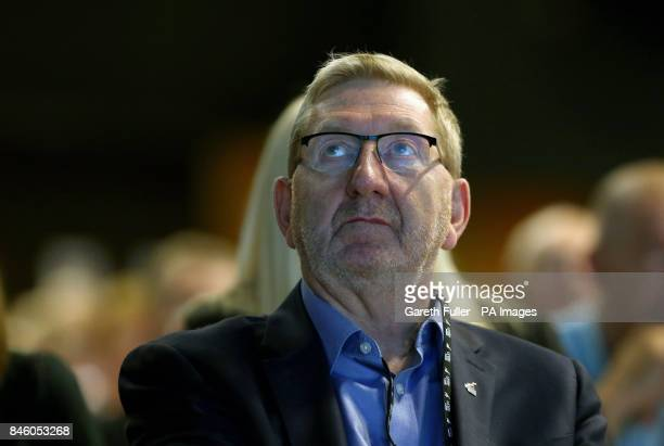 Unite General Secretary Len McCluskey listens to the speech of Labour leader Jeremy Corbyn at the TUC conference at the Brighton Centre in Brighton