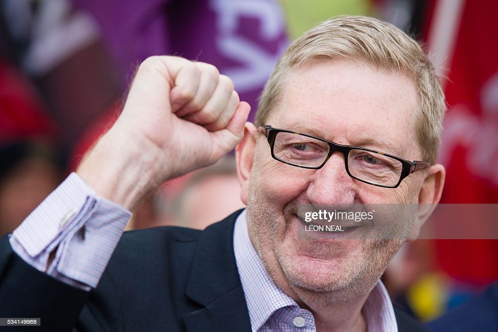Unite union General Secretary Len McCluskey gestures as he joins steel workers following a march through central London on May 25, 2016. Britain's business minister Sajid Javid met Tata Steel bosses in Mumbai ahead of a crunch board meeting on Wednesday expected to discuss potential buyers for its loss-making UK assets. Tata Steel, Britain's biggest steel employer, announced in March that it planned to sell its Port Talbot plant in Wales and other assets, putting 15,000 jobs at risk. / AFP / LEON