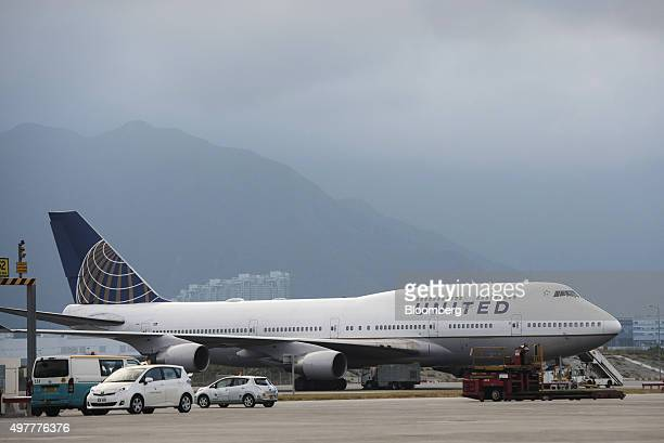 A United Airline aircraft operated by United Continental Holdings Inc sits on the tarmac at Hong Kong International Airport in Hong Kong China on...