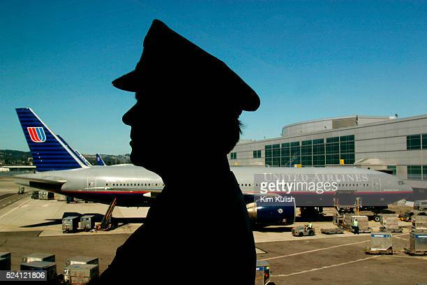 United Airlines 777 Captain Pat Palazzolo in front of an UA plane at San Francisco International Airport United Airlines bleeds billions of dollars...