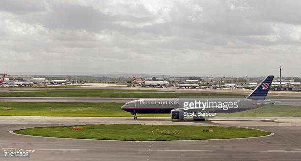 United Airlines aircraft taxis down the runway at London Heathrow Airport on May 18 2006 in London England Heathrow consists of four passenger...
