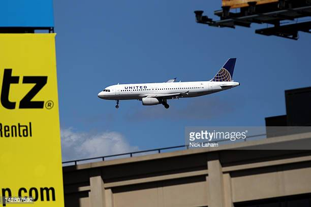 United Airlines airplane flies along it's landing path towards LaGuardia International Airport as the New York Mets host the Atlanta Braves during...
