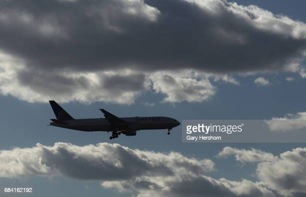 United Airlines airplane passes through clouds on approach to Newark Liberty Airport on May 15 as seen from Elizabeth New Jersey